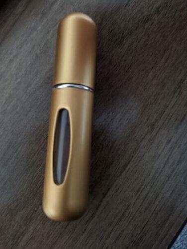 mini travel perfume bottle in golden color